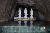 3 statues that greet you as you walk into the tunnel going to the mountain temple