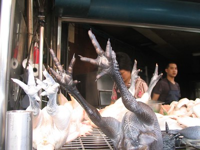 At this point we started wandering through the alleys full of food vendors.  Yes.  These are black chicken feet.