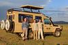 Chiu-Ki, Francois and his father by the safari car