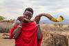 Masai playing a horn