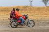 Masai riding a motocycle