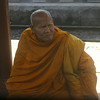 A monk at a train station
