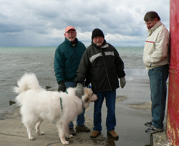 Shadow and (from left) Dad, Jim and Steve