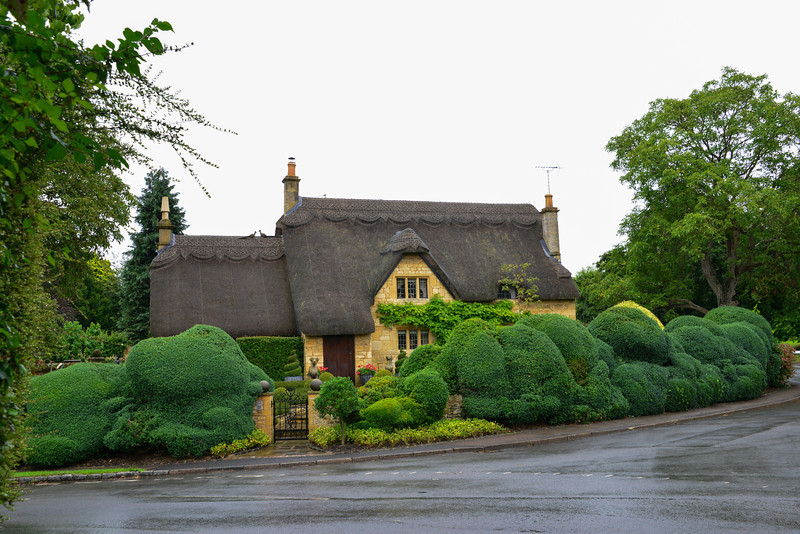"The stylish, charming thatched roof cottages with English country gardens have a ""fairy tale"" quality."