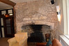 "On the left corner of the fireplace remains the ""witch marks"" etched into the stone, said to ward off evil spirits, a medieval frieze.  A leper pit also remians in the oldest part of the cellar."