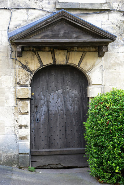 The Town of Painswick<br /> <br /> On Bisley Street are houses from the 14th century which still show two so-called Donkey Doors. These doors may seem extraordinarily wide by today's standards, but there is a reason for this width; they were built to allow a donkey laden with panniers of wool to pass through.