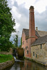 The Old Mill, Lower Slaughter. <br /> The Old Mill is to be found, just round the corner of the cottage with the dormer windows, where the River Eye meets the north-western edge of the village. It is open to the public as a museum and shop.<br /> <br /> The red brick chimney is part of the mill and the mill has the only brickwork to be seen in Lower Slaughter.