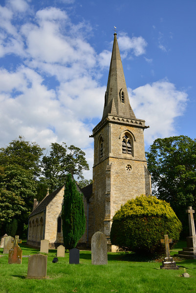 St. Mary's Church, Lower Slaughter. <br /> This is a pretty church with an impressive spire but not really very old having been re-built in 1867. There remain, however, some 13th century arches between the nave and south aisle.