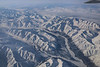 Flying to Nome from Anchorage.  The distance is approximately 539 air miles.  There isn't a road in sight.