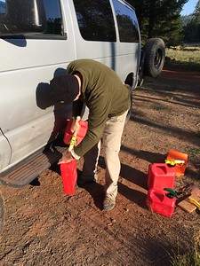Doom and gloom and Armageddon was predicted, so we brought 7 gallons of extra gas. This is after the eclipse, and Joe is filling the van.