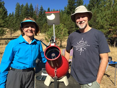 Sherry's Edmund Scientific Astroscan 2000 telescope projecting the partial phases of the eclipse, in Keeney Meadows, OR.