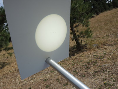 The projection is large enough to see sunspots. This is the day before, so no eclipse yet.