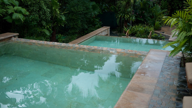 a cooler pool on top, dropping into a warmer one at the bottom