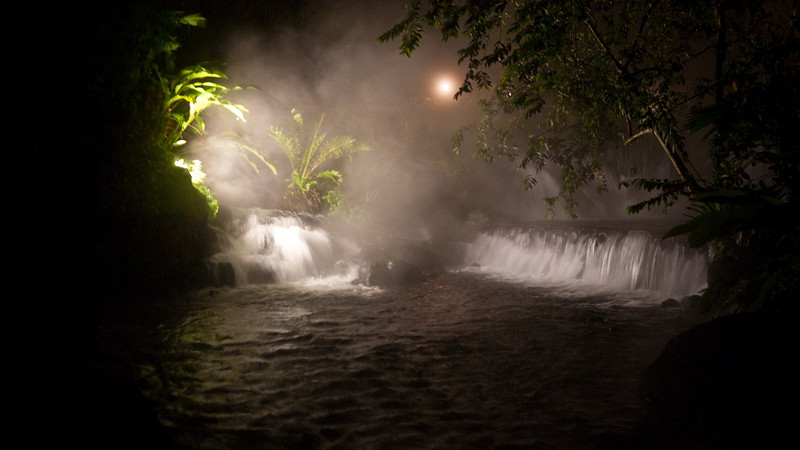 the springs at night, surrounded by steam