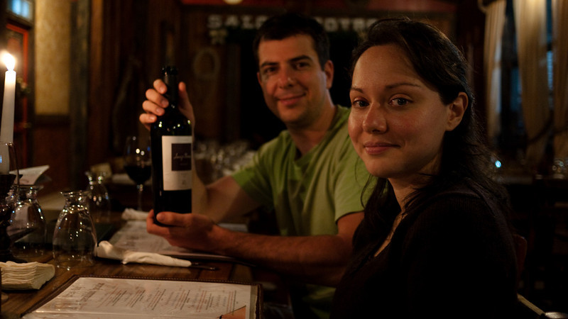 Roxi and Slava at a nearby steakhouse, sampling the wine