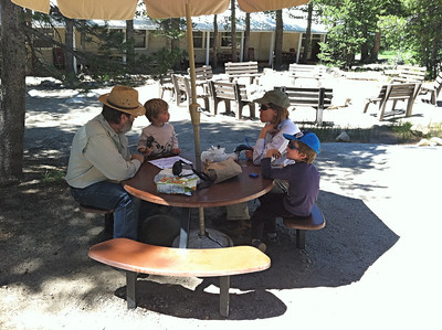 Picnic tables by the firecircle and Tuolumne Meadows Lodge