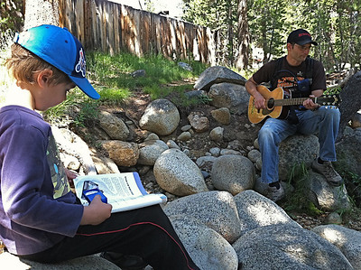 Music and reading by the river