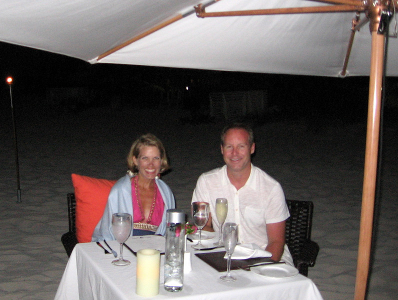 Romantic dinner on the beach with only tiki torches lighting our way.