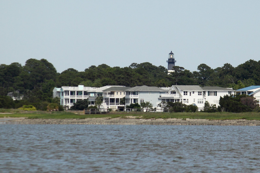 Tybee Island Lighthouse looking over some inlet houses.