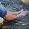 Kim's feet soaking in the Yellowstone River
