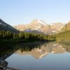 Mountains reflected in Lake McDonald, Glacier National Park.