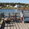 Kim on our bike ride taking a break near Newagen on Southport Island, Maine.