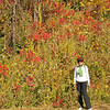 Kim stands by some sumac in full color.