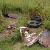 Collection of rusty auto parts and tires at the trailhead