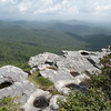 I loved this vantage point looking off Hawksbill Mtn. <br /> All the weathered potholes of standing water and the irregular shape of the rim of rock.