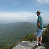 Kenny gazing down into the Linville Gorge and toward the river in the distance. <br /> Table Rock summit. NC