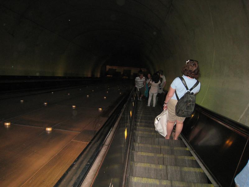 "Long escalator ride down to the ""Metro"" subway"