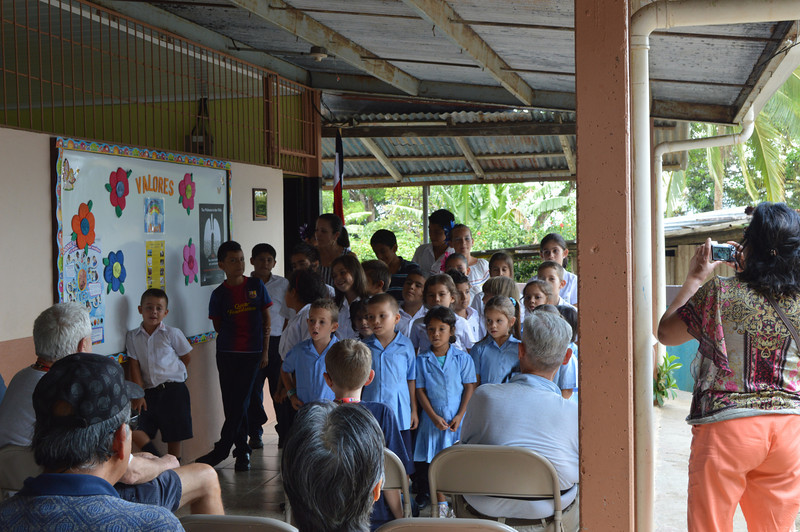 """The children, who could not speak English, sang """"America the beautiful"""" in English."""