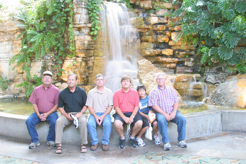 Mark with Dad and four uncles in the Crown Center of KC.