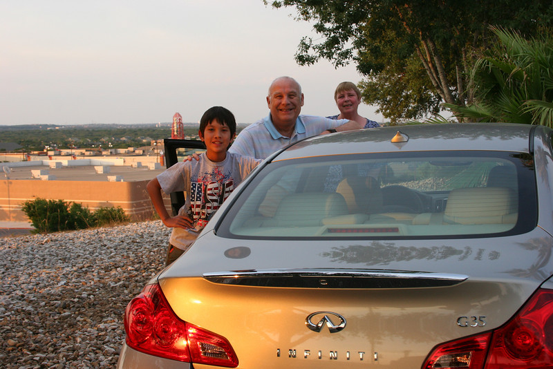 Tony and Allison with Mark showing off their new car.