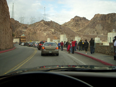 Driving onto Hoover Dam there were plenty of Tourists walking around on Thanksgiving afternoon. In days gone by vans trucks etc were all allowed to cross over on the dams road. Since 9-11 stricter security rules have been applied and only light passenger cars are allowed to pass over once they have been through a check point. To overcome the inconvenience of a long detour a new road and bridge is being built that sits much higher than the dam.