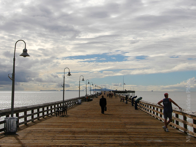man on pier with briefcase