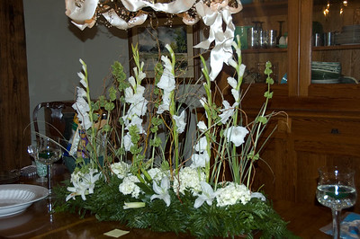 The dinning room table featured a beautiful arrangement of Glads, Bells of Ireland, Lilies, and fern.