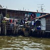 Residents of Bangkok live right on the river in varying conditions
