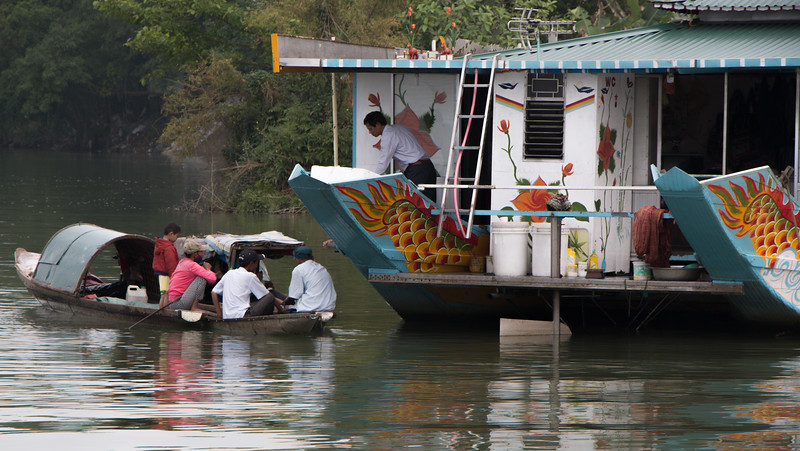 Most likely family members bringing supplies to another Dragon boat preparing for the days cruise