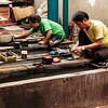 One of our stops in Saigon was to a lacquer factory. Here these workman are preparing for their product.