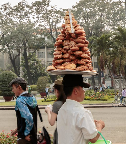 Local vendor carrying his wares on his head!
