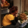 A young woman sitting waiting for her next customer