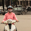 Lots of motorcycle and scooter riders wore masks to help reduce the amount of pollution they inhaled
