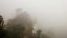 Outside our room, the fog already wraps the entire mountain.  --  Dehors, le brouillard enveloppe la montagne.