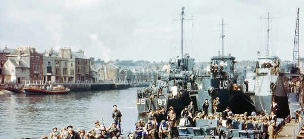 June 1944: Boats full of US troops wait to leave Weymouth to take part in Operation Overlord. 5 April 2014: A view of the harbour of the English town today. This location was used as a launching place for Allied troops participating in the invasion of Nazi-occupied France on D-day. Photographs by Galerie Bilderwelt/Getty and Peter Macdiarmid/Getty
