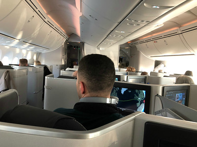 Air Canada.  We went thru a successful bidding process and wound up in Biz Class for the long flight.  Coming back, we travelled in a coach upgrade. on the return trip and it worked out just fine.
