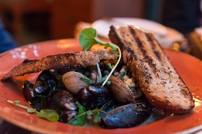Steamed Mussels and Clams Lemon, Huille d'Olive, Spring Herbs, Artisan Bread