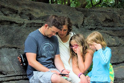 Chris showing the girls a funny video on his phone.  A break from looking at all the wildlife.