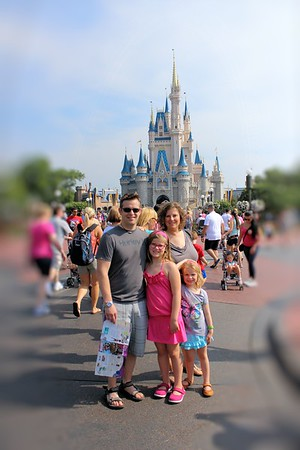 Chris, Lorinda, Anissa, & Makenna in front of the Disney Castle. In Walt Disney World it is Cinderella Castle.  Where at Disney Land it is Sleeping Beauty's Castle.