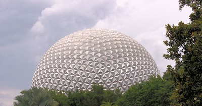 I really loved taking pictures of Spaceship Earth.  Geometrically, Spaceship Earth is a derivative of a pentakis dodecahedron, with each of the 60 isosceles triangle faces divided into 16 smaller triangles (with a bit of fudging to make it rounder). Each of those 960 flat panels is sub-divided into four triangles, each of which is divided into three isosceles triangles to form each point. In theory, there are 11,520 total isosceles triangles forming 3840 points. In reality, some of those triangles are partially or fully nonexistent due to supports and doors; there are actually only 11,324 silvered facets, with 954 partial or full flat triangular panels.